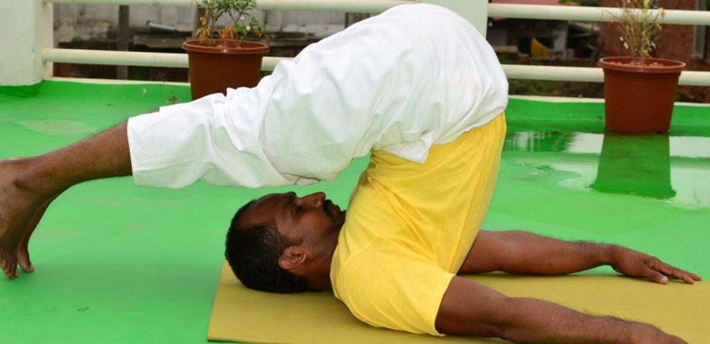 Learn yoga Halasana Plow posture read in Fine dining Indian magazine
