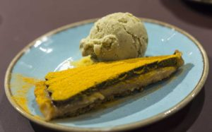 Chocolate Turmeric torte with pistachio ice cream Temper city restaurant food tasting by Fine dining indian food magazine
